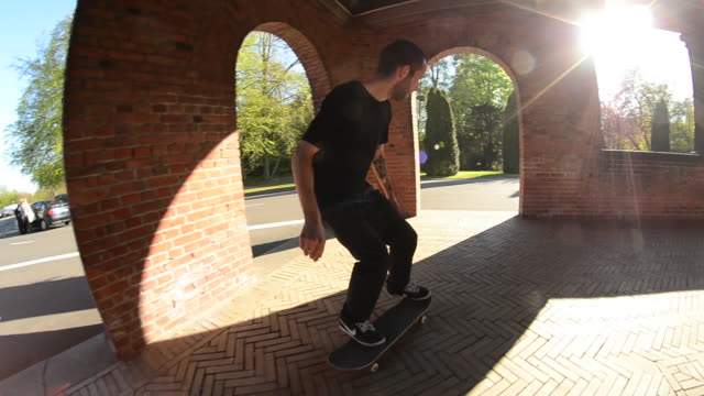 A skateboarder doing a trick. - 1920x1080
