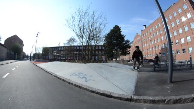 a skateboarder doing a trick. - 1920x1080 - oresund region stock videos & royalty-free footage