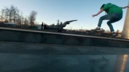 Skateboarder failed tricks on the ramp outdoors in sunset