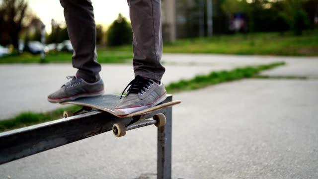 skateboarder grinding down rail - skateboard stock videos & royalty-free footage