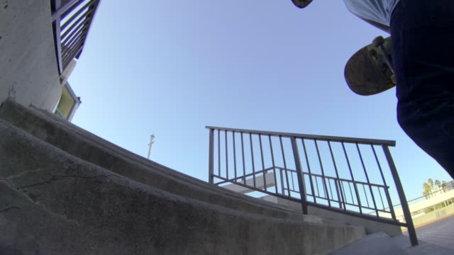 a skateboarder jumping a staircase. - goodsportvideo stock videos and b-roll footage