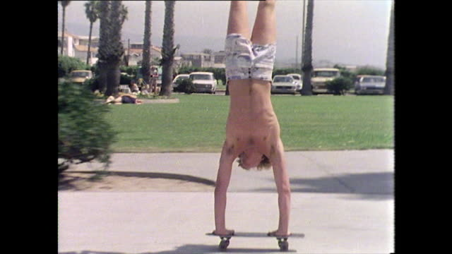 skateboarder performs handstand on moving skateboard - balance stock videos & royalty-free footage