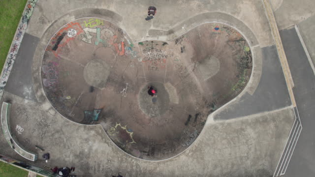 skateboarder riding a bowl at skatepark - sports activity stock videos & royalty-free footage