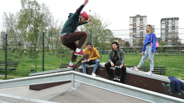 skateboarder showing tricks and jumps in skate park with friends - slow motion - eastern european culture stock videos & royalty-free footage