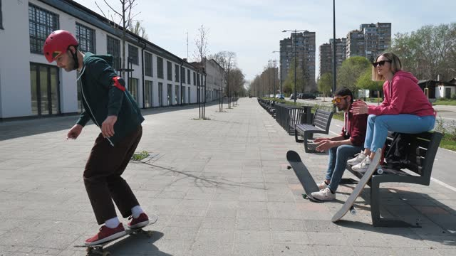 skateboarder showing tricks and jumps on the street on sunny day - slow motion - eastern european culture stock videos & royalty-free footage