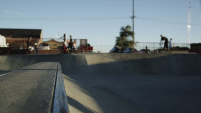 MS Skateboarder sliding and falling on ramp in skatepark / Orem, Utah, USA