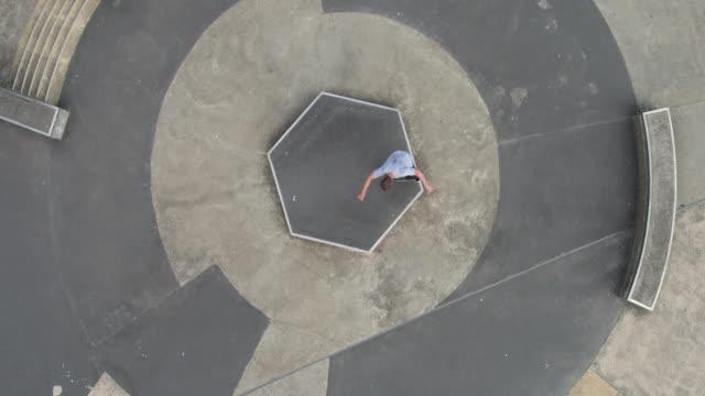 skateboarder tricks at skatepark - staffordshire england stock videos & royalty-free footage