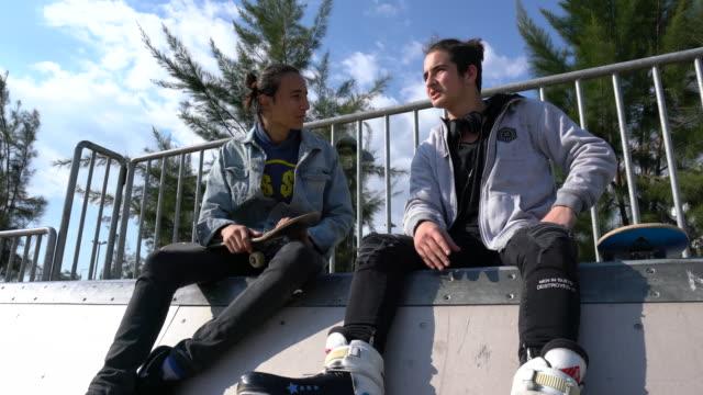 skateboarder - sitting stock videos & royalty-free footage