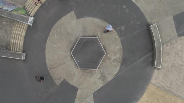 skateboarders doing tricks at skatepark - staffordshire england stock videos & royalty-free footage