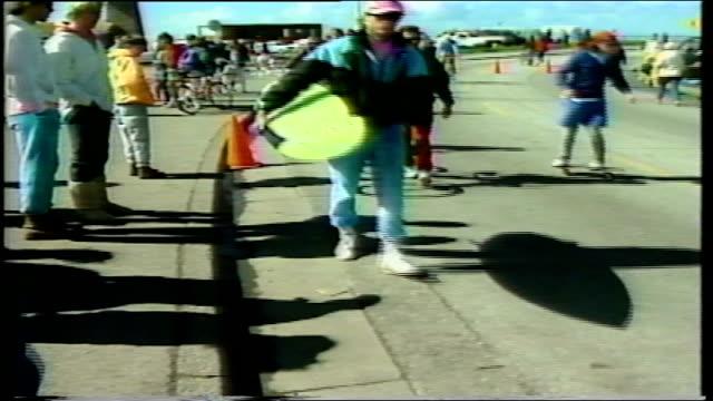 skateboarders performing tricks on crowded street - 1990 stock-videos und b-roll-filmmaterial