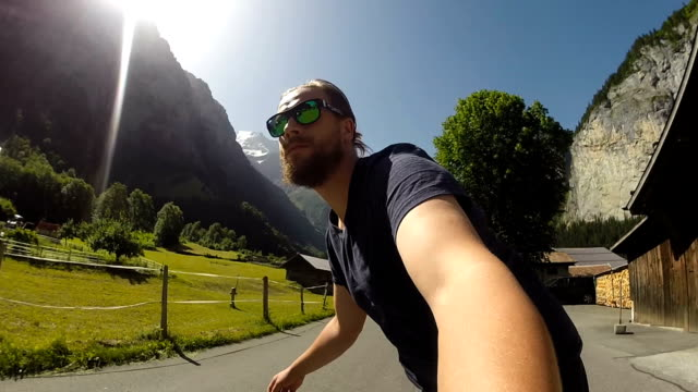 skateboarding through an iconic swiss valley - longboarding stock videos & royalty-free footage