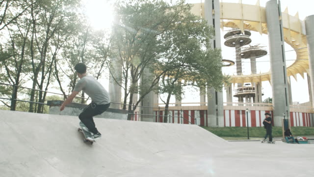 a skateborder shreds during the summer of 2017 in slow motion - 4k - sports ramp stock videos and b-roll footage