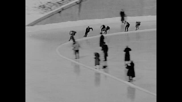 us skater jack shea wins speed skating race at 1932 winter olympics / ground level footage of race finish / he speaks / note exact day not known - 1932 winter olympics lake placid stock videos and b-roll footage