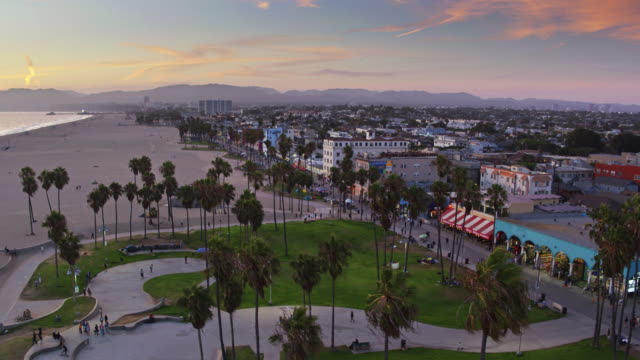 skaters and strollers on venice beach at sunset - drone shot - venice beach stock videos and b-roll footage