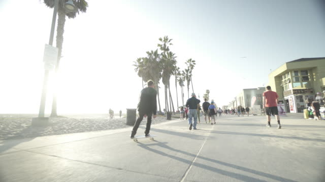 skating down venice boardwalk. - california stock videos & royalty-free footage