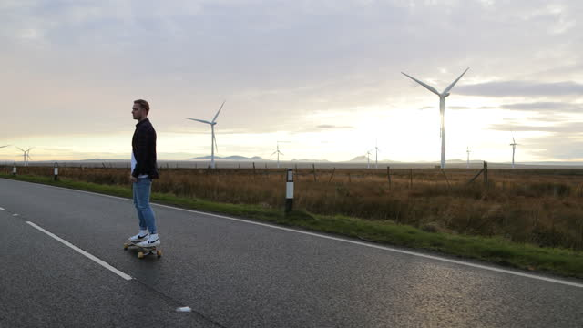 skating on the open road - sustainable energy stock videos & royalty-free footage