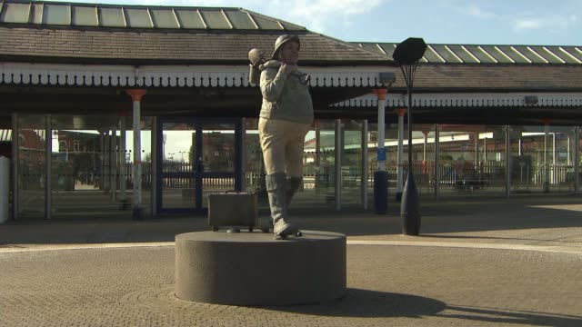 skegness local council considering dropping town mascot; england: lincolnshire: skegness: ext gv jolly fisherman statue date unknown women posing... - jolly video stock e b–roll