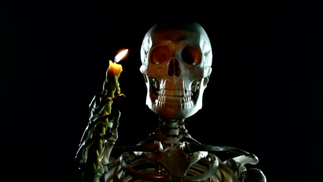 Skeletal with a candle