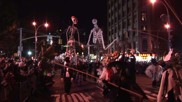 skeleton procession, chinese dragon and giant eyeball float. nyc village halloween parade on october 31, 2011 in new york, new york - parade stock videos & royalty-free footage