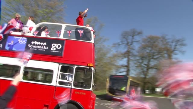 Skeleton racer Lizzy Yarnold returns to Sevenoaks after Winter Olympics ENGLAND Kent Sevenoaks EXT Lizzy Yarnold on top of bus waving Union Jack flag...