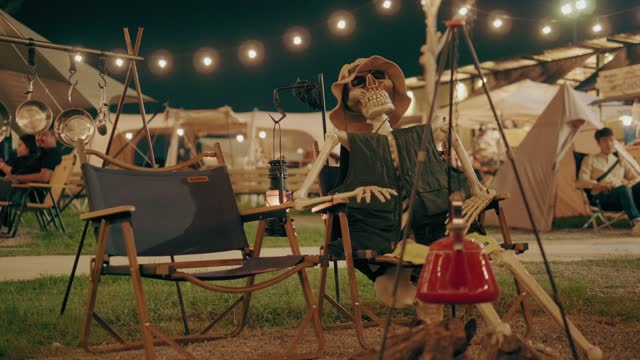 skeleton with camping cloth sitting on the chair with camping halloween-stock video - waiting stock videos & royalty-free footage
