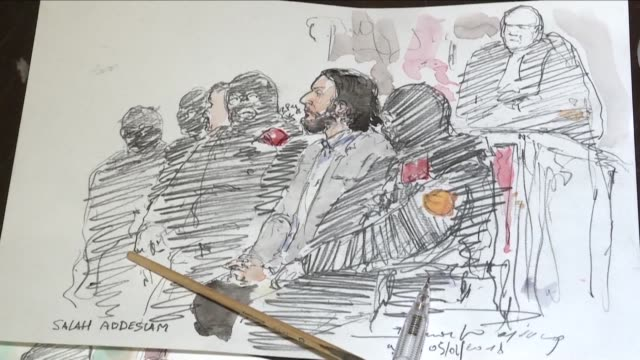 A sketch artist works on a drawing of Salah Abdeslam as he appears in front of a Belgian court
