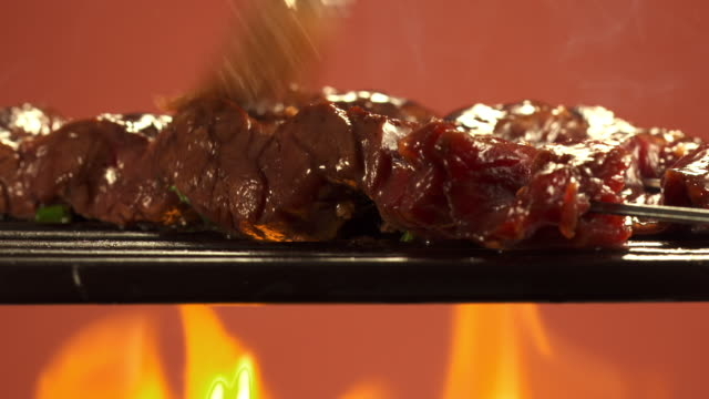MS Skewer with cubes of marinated beef being basted / Los Angeles, California, United States