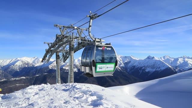 Ski Gondola arrives at the Mountain peak of the Rosa Khutor Alpine Center Krasnaya Polyana General Views Of Sochi Location for 2014 Winter Olympics...
