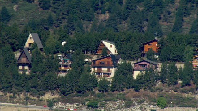 LOW AERIAL, Ski huts in mountain landscape, Les Angles, Languedoc-Roussillon, France