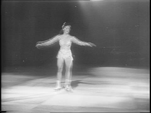 Ski jumper does somersault falls down run / ice boats skate across frozen lake / skaters lace ice skates / highlights of 1945 Ice Capades tour /...