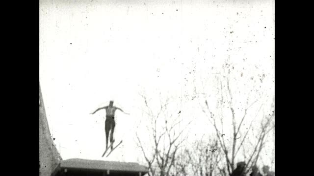 a ski jumper makes a landing at the olympics in 1932 - lake placid town stock videos and b-roll footage
