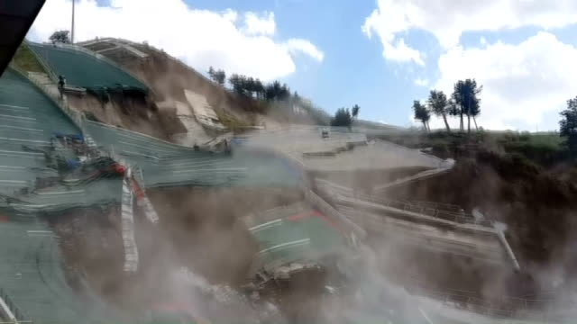 ski jumping towers which was built in 2011 for the winter universiade collapse in erzurum turkey on july 15 2014 - nordic skiing event stock videos and b-roll footage