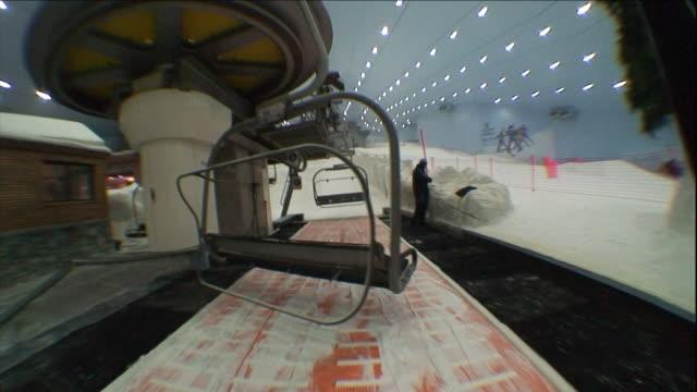 a ski lift carries passengers up the slope at the ski dubai resort. - ski lift stock videos & royalty-free footage