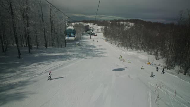 ski lift ride stock video - alpine skiing stock videos & royalty-free footage