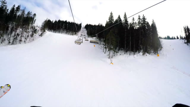pov ski lift. - seggiovia video stock e b–roll