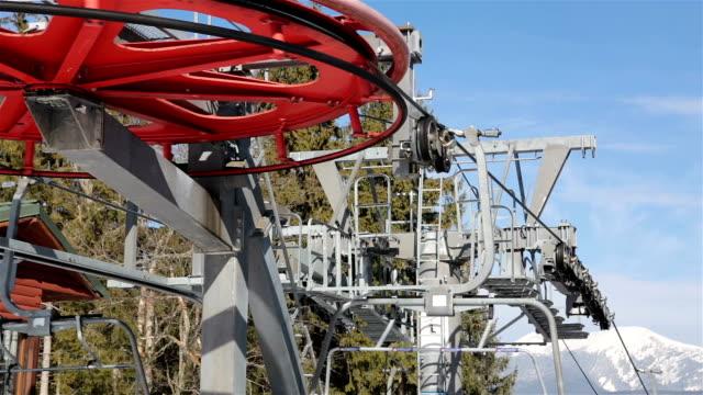 Ski lift wheel on the top of the mountain.