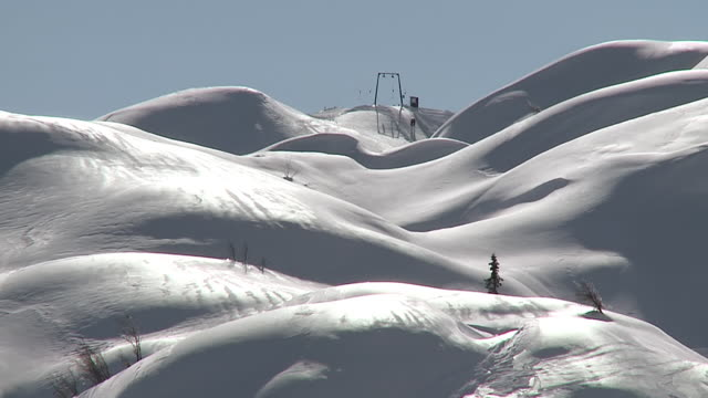 stockvideo's en b-roll-footage met ws ski lifts on snow covering slopes / bohinj, triglav, slovenia - stilstaande camera