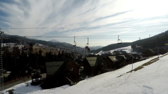 ski lifts with skiers are moving up. - ukraine stock videos and b-roll footage