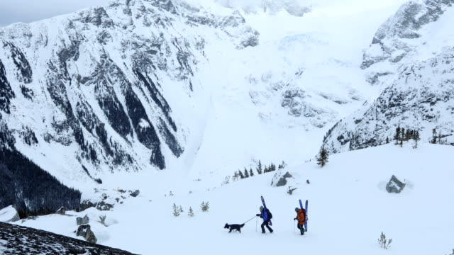 ski mountaineers make their final approach along summit ridge - ascentxmedia stock videos & royalty-free footage