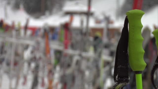rf ski pole with ski racks in backgroud / lake louise, alberta, canada - ski pole stock videos & royalty-free footage