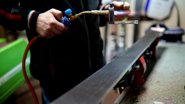 ski repair shop - repairing stock videos & royalty-free footage