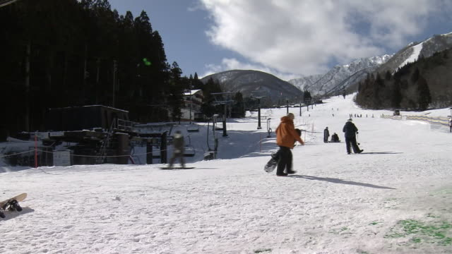 ski resort at snow shortage, nagano, japan - ski resort stock videos & royalty-free footage