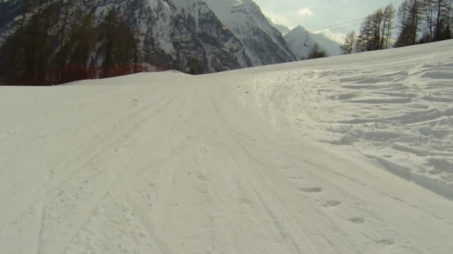 pov ski ride in high mountain landscape - ski slope stock videos & royalty-free footage