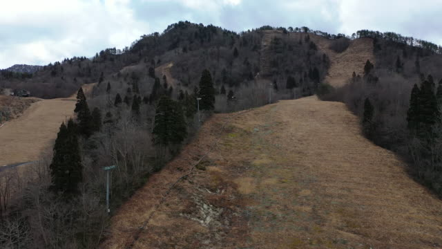 ski slopes that have had to be closed because of a lack of snow are pictured on january 30, 2020 in minamiuonuma, japan. large parts of japan are... - 30 seconds or greater video stock e b–roll