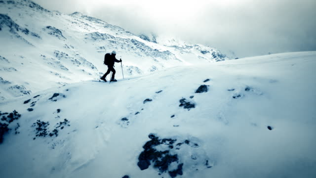aerial ski touring over the mountain ridge - winter stock videos & royalty-free footage