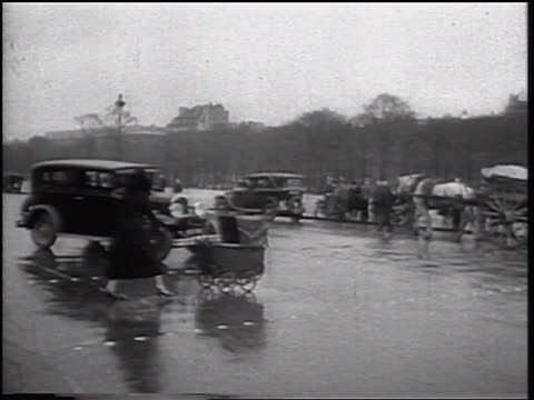 b/w 1934 skidding car hitting baby carriage + woman walking in street / staged car accident - 1934 stock videos & royalty-free footage
