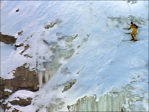 skier base jumping off edge of icy cliff - cliff stock videos & royalty-free footage