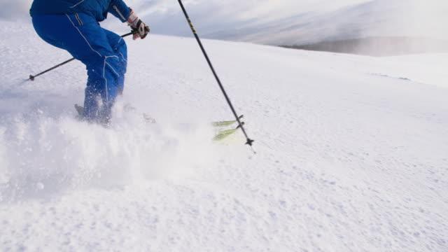 SLO MO Skier carving down ski slope