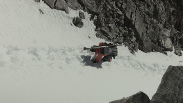skier climbing down in french alps. - ski jacket stock videos and b-roll footage