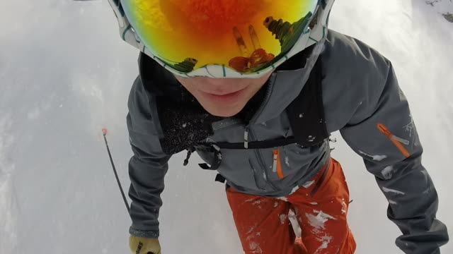 pov of skier descending powder snow slope - skiing stock videos & royalty-free footage